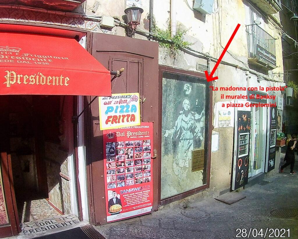 """""""La madonna con la pistola"""" il murales di Banksy a piazza Gerolomini"""